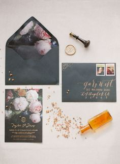 floral and black wedding stationery