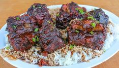 Beef Oxtail Recipe slow-smoked and cooked on the smoker with a rich braising liquid and great BBQ flavors. Uds Smoker, Oxtail Recipes, Beef Recipes, Cooking Recipes, Jamaican Recipes, Savoury Recipes, Curry Recipes, Soup Recipes, Smoker Recipes