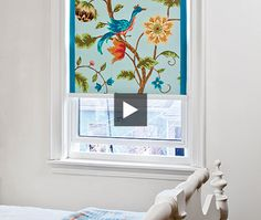 Cover in expensive roller blinds with wallpaper for a custom look. Free video tutorial.