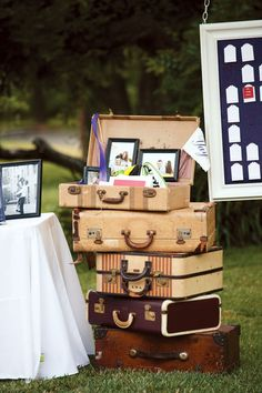 Old suitcases brimming with sentimental artifacts and pictures of the bride and groom added to the vintage-style décor.