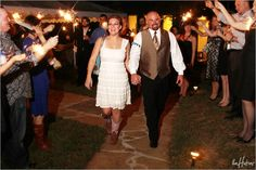 Sparkler leaving with a cute, short white dress and cowboy boots! - Photo by Jeremy