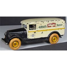 Arcade Toy Co. Hathaway's Bread & Cake Cast Iron International Delivery Toy Truck. Excellent original condition. 9 1/2 inches long.