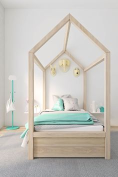 While four poster beds may not be the most minimalist, this design is simple and fun without skimping on kid-friendly decor.