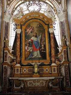 San Luigi dei Francesi, Rome.  Chapel of St. Louis.  Plautilla Bricci painted the altarpiece of the saint.  It is framed in yellow marble.  The Corinthian columns are in red and white marble.