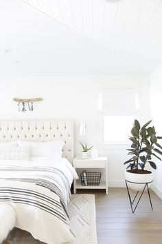 Simply White by Benjamin Moore Bedroom The Master bedroom looks out onto our backyard and has vaulted tongue and groove ceilings for added height The floors here and throughout the house are a French Oak wood with a custom stain #SimplyWhitebyBenjaminMoore #Bedroom