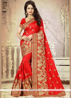 Unique elegance can come out through the dressing design with this red art silk traditional designer saree. You could see some interesting patterns completed with embroidered and patch border work. Co...