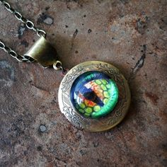 The Dragon's Eye Locket, EXCLUSIVE DESIGN Only by Enchanted Lockets, Gothic Fantasy, Sorcerer's Locket, Medieval Locket. $24.00, via Etsy.