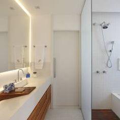 Cobertura Leblon : Banheiros Eclético por Escala Arquitetura