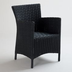 Black All-Weather Wicker Solano Dining Armchair. World Market. Normally hate wicker-but black with a nice printed cushion could be okay for the front porch. $97.99  SKU# 469529