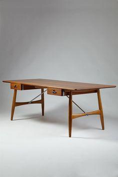 Wegner, Hans Desk designed by Hans Wegner for Johannes Hansen, Denmark. 1952. - Solid teak, oak and chromed steel.