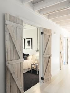 Ceiling beams, barn doors, white floors