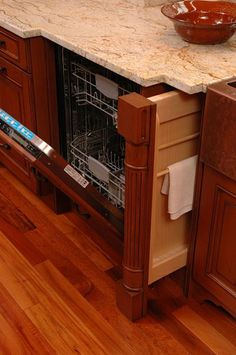 Remodeled kitchen with custom cabinet for towel storage by Neal's Design Remodel.