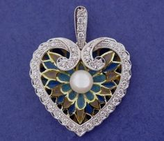 PENDANT: yellow and white gold, 37 diamonds 0,38 ct., 1 pearl and enamels. 01MP0128