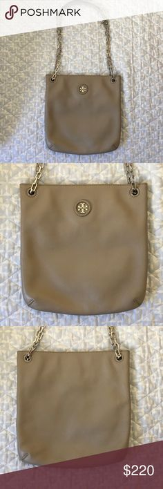 Tory Burch Britten Swingpack NWOT Tory Burch Britten Leather Swingpack in French Gray. It's a flat cross body/shoulder bag, it has one inside zip pocket and a magnetic snap closure. The handle can be worn long like a cross body or doubled to be used as a shoulder bag. Tory Burch Bags Crossbody Bags