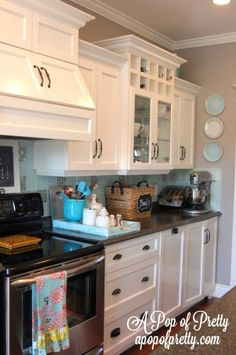 I like...gray wall, white shaker cabinet, dark hardware, hardwood floors I don't like...that the cabinets aren't ceiling height, stainless steel appliances,