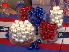 Christmas in July! Pull out your holiday ornaments in red, white and blue and throw them in glass bowls and vases for easy centerpieces.