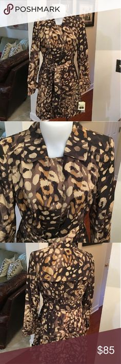Trench Coat Elegant trench coat in an abstract leopard print. Earthtones go with everything! Hidden button closure and tie belt. Jones New York Jackets & Coats Trench Coats