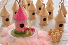 paint your own fairy house...look at cute fairies to go with it.