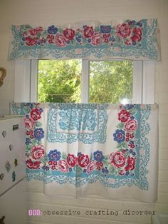 Vintage tablecloth turned to curtains!  I would never cut up an usable tablecloth, but a cutter would be fantabulous as these curtains.