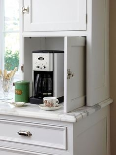 Things We Love: Chic Coffee Bars - Design Chic  - love the compartment for coffee in the kitchen- amazing hardware and the marble countertops...gorgeous!