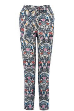 A tie waist, gently tapered leg and silky feel make these the sporty trousers…