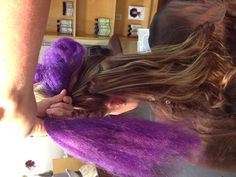 Step 11. Now take unteased hair and the entire length of purple and combine,  pulling hair over to the left.