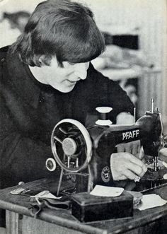 John at a sewing machine ❤ and what was he sewing?? And it's a treadle, to boot. ah, John. We miss you. PS the machine is not a Singer. The singer is John!