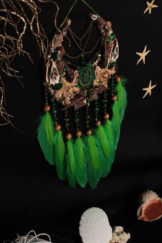bohemian decor for christmas Bohemian Design, Bohemian Decor, Moon Dreamcatcher, Horseshoe Crafts, Dream Catchers, Trending Outfits, Unique Jewelry, Handmade Gifts, Shell
