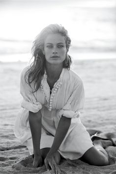 Carolyn Murphy in the perfect white coverup. Sand and Surf in BAZAAR.