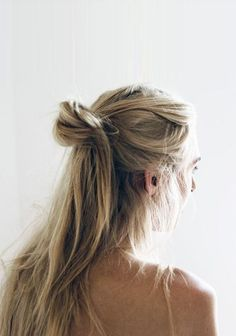 Blonde half-up top knot.