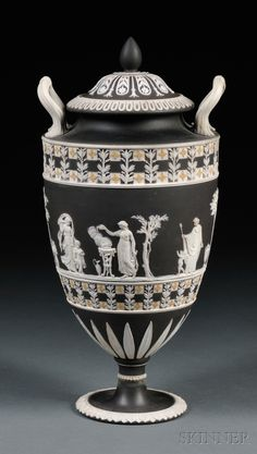 Wedgwood Three-color Jasper Dip Diceware Vase and Cover, England, mid-19th century, black ground with applied yellow quatrefoils and white foliage bordering a central frieze of classical figures.