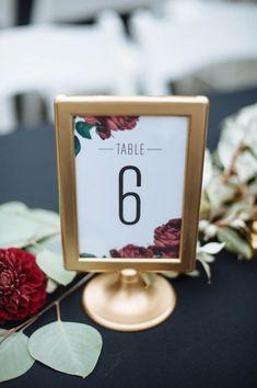 Botanical gold-framed table number | Erica Rose Photography