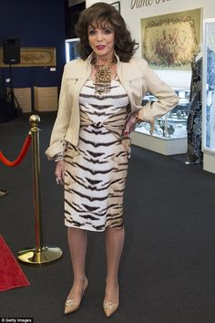 Wild thing: Joan Collins made an appearance in Los Angeles on Monday ahead of auctioning o...