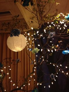 For prom cut tress down, put them in cement in pots and add tissue paper flowers and lights, bam enchanted forest.