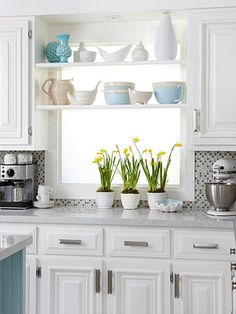 Small kitchen decorating ideas... Love the shelves over the window. Great way to add storage space and display pretty vases and servingware.