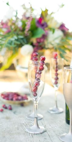 Frozen cranberry stirrers to keep your champagne chilled.