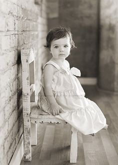 Betty when she was 1 year old sitting on that little chair. So cute!