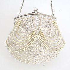 Beaded pearl bridal handbag. Ivory pearl beaded purse designed by Moyna.