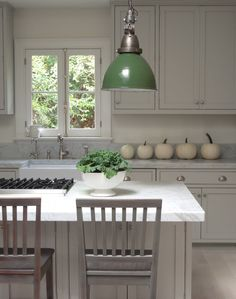 vintage green industrial pendants in marble white kitchen of Loi Thai
