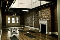 hot yoga studio, Epic Yoga, Dupont Circle. Fireplace and brick on one wall.. would we awesome to have a fire heat the studio.