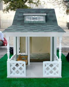 A couple of the entries in: BARKITECTURE 2012 This quaint canine farmhouse by Henley Homes is equipped with a front porch, swing, dormer window and white picket fence. By Kara Mosher The rest of the houses are on my Cabins/Treehouses board. Cool Dog Houses, Play Houses, Farmhouse Porch Swings, Henley Homes, White Picket Fence, Picket Fences, Dog Rooms, Outdoor Spaces, Outdoor Decor