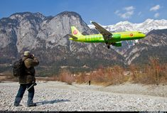 My buddy Tom catch the approaching S7 Airlines Airbus A320 with his Nikon D80 and Nikon D7100 in front of the mountains of the 'Nordkette'. Maybe one of the most beautiful spotting locations on our planet - a sunny spotting weekend with a good friend on a very cool airport surounded by the tyrol mountains.