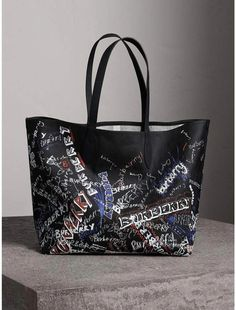 a91c8414786 A reversible tote in coated canvas