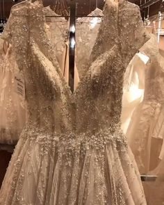 All of the sparkle and shine a bride could ever ask for is here with Fiore Couture. We have the most exquisite beaded gowns waiting for you. Click on the video for more info and styles. #weddingideas #weddinggowns Wedding Events, Wedding Gowns, Weddings, Welcome To Our Wedding, Beaded Gown, Dress Silhouette, Prom Dresses, Formal Dresses, How To Run Longer