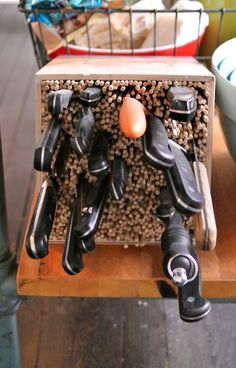 Bunch skewers in a box and insert knives for storage - fits any size knife anywhere in box -- 60 New Uses For Everyday Items