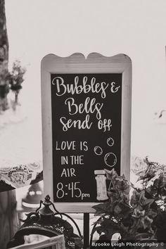 "Send of chalkboard sign that says ""bubbles & bells send off"" Wedding Signage, Rustic Wedding, Wedding Venues, Wedding Photos, Oklahoma Wedding, Signature Cocktail, Chalkboard Signs, Wedding In The Woods, Spring Wedding"