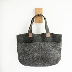 "Say hello to the perfect weekend getaway bag. Super soft, extra durable washed linen tote bag with interior pocket + leather accents. * Dimensions: 21"" l x 6 1/4"" w x 14"" h                                                                                                                                                                                 More"