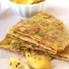 Sharing with you whole wheat Indian flat bread stuffed with spicy potatoes and peas stuffing. Served with homemade, healthy Lemon Preserve.