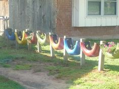 Half tyres painted and potted to use as a fence.