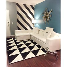 Rooms that already have bold wall or furniture colors such as orange, burgundy, or even here turquoise or blue tend to have heavy saturation in them. The way to unite the floor with the bold walls is by using bold patterned neutral area rugs. The look is pulled together and not over powering to the eyes. #ContemporaryEssentials #VincenteWatson #InteriorDecor Diy Apartment Decor, Colorful Furniture, Interior Decorating, Burgundy, Flooring, Contemporary, Neutral, Area Rugs, Walls